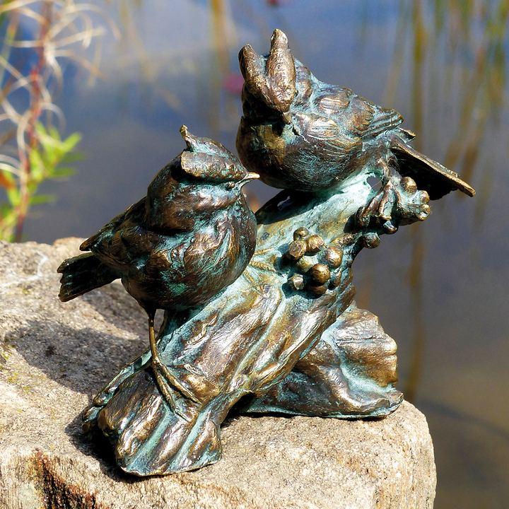 Vogelpaar auf Bronzeast